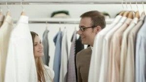 stock-footage-male-customer-speaking-to-sales-manager-in-fashion-store-while-shopping-for-clothes